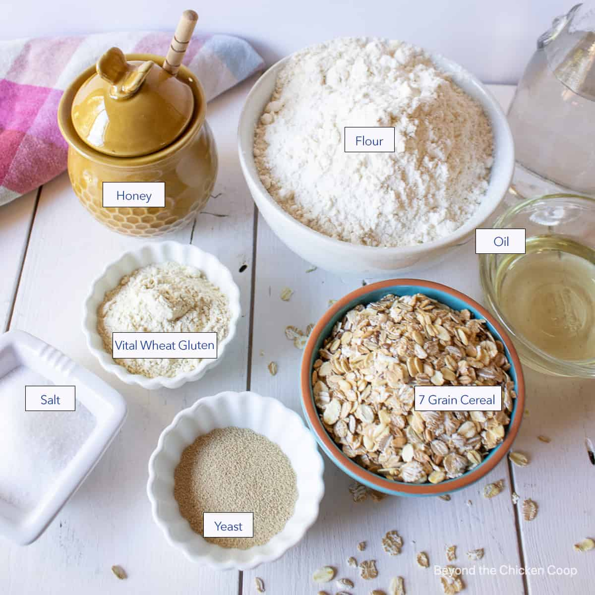 Small bowls filled with flour, oats and other ingredients.