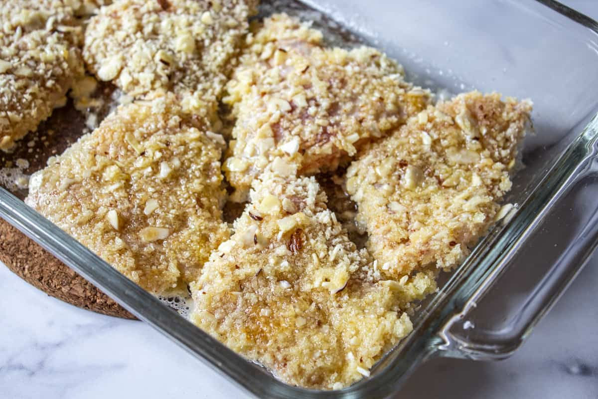 Fish fillets in a glass baking dish.
