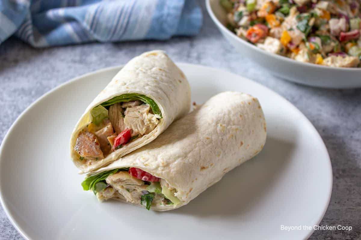 A tortilla wrapped filled with chopped chicken.