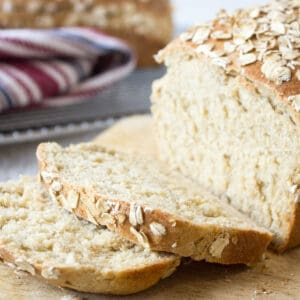 A loaf of wheat bread topped with oats.