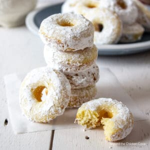 Small donuts covered in powdered sugar.