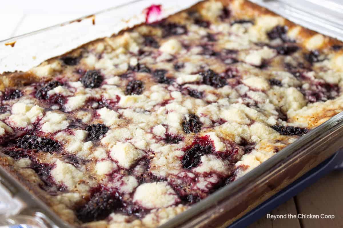 A blackberry dessert in a glass baking dish.