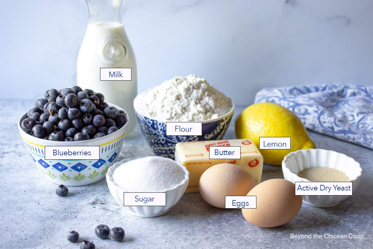 An arrangement of ingredients needed for making blueberry sweet rolls.
