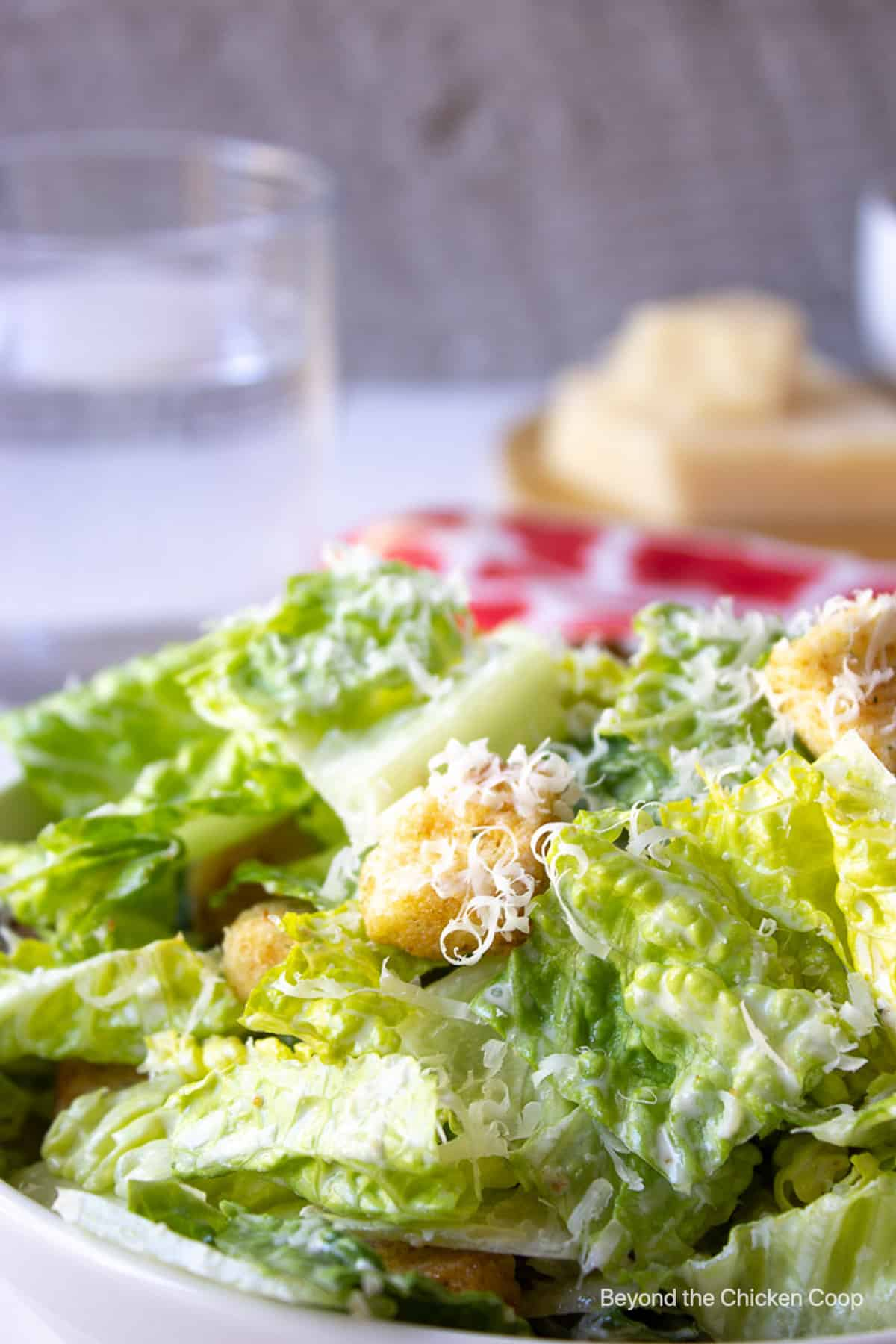 A green salad topped with shredded cheese and croutons.