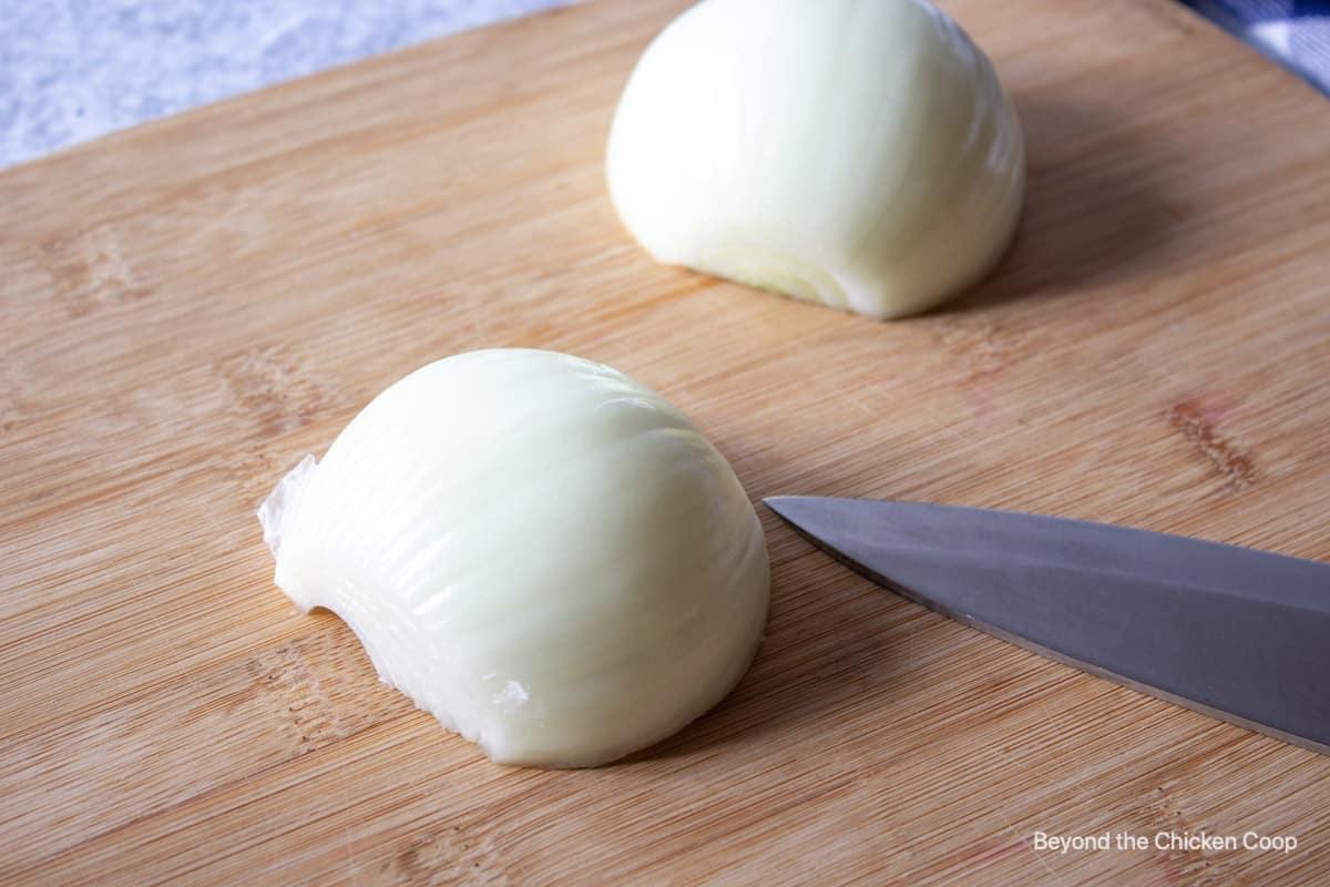 A half of an onion on a cutting board.
