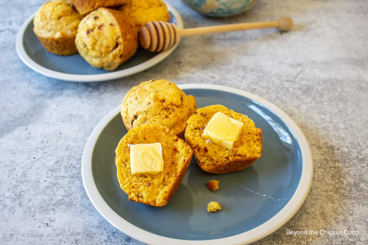 Chipotle Muffins cut in half and topped with butter and honey.