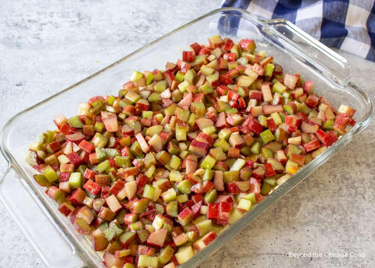 Cut rhubarb in a baking dish.