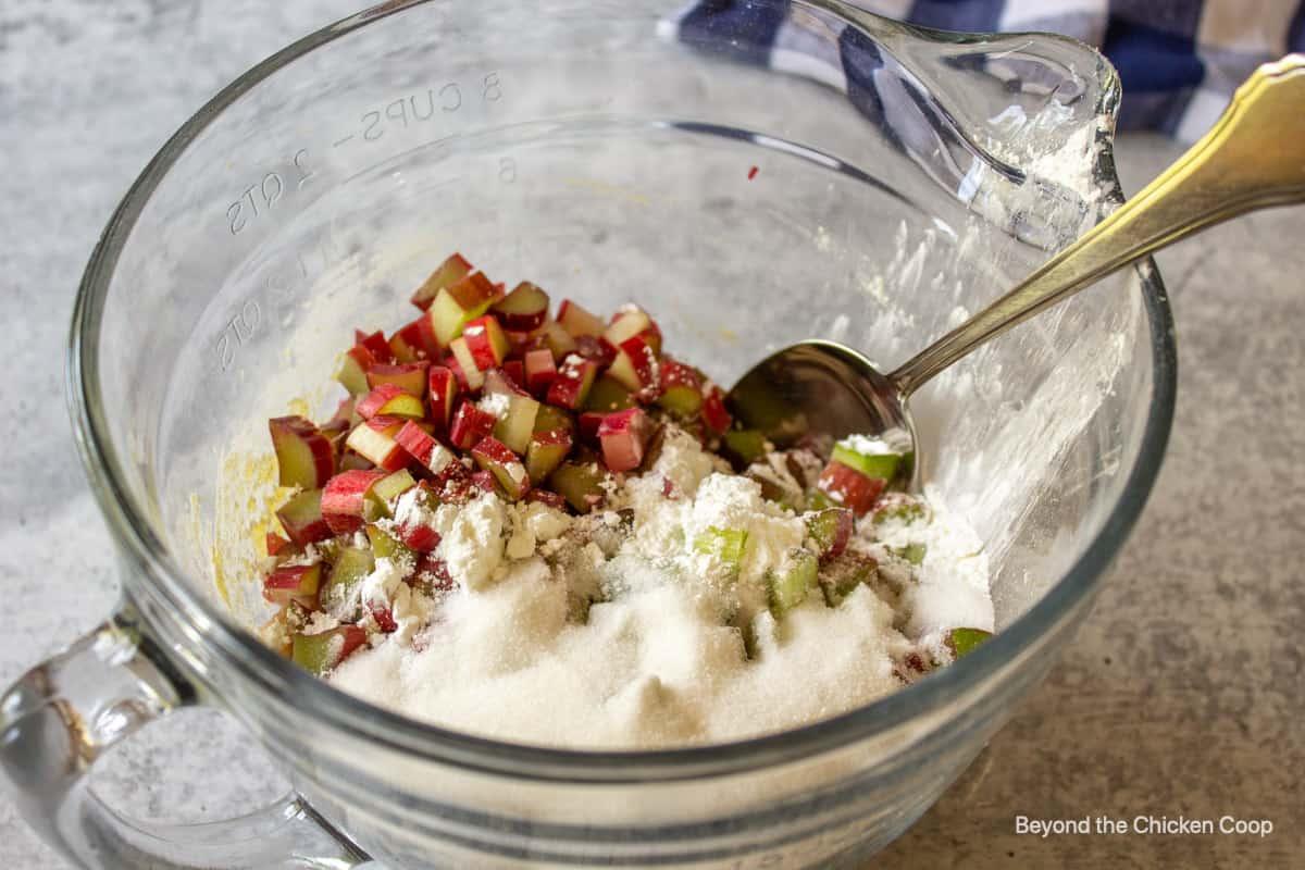 Rhubarb with sugar in a bowl.