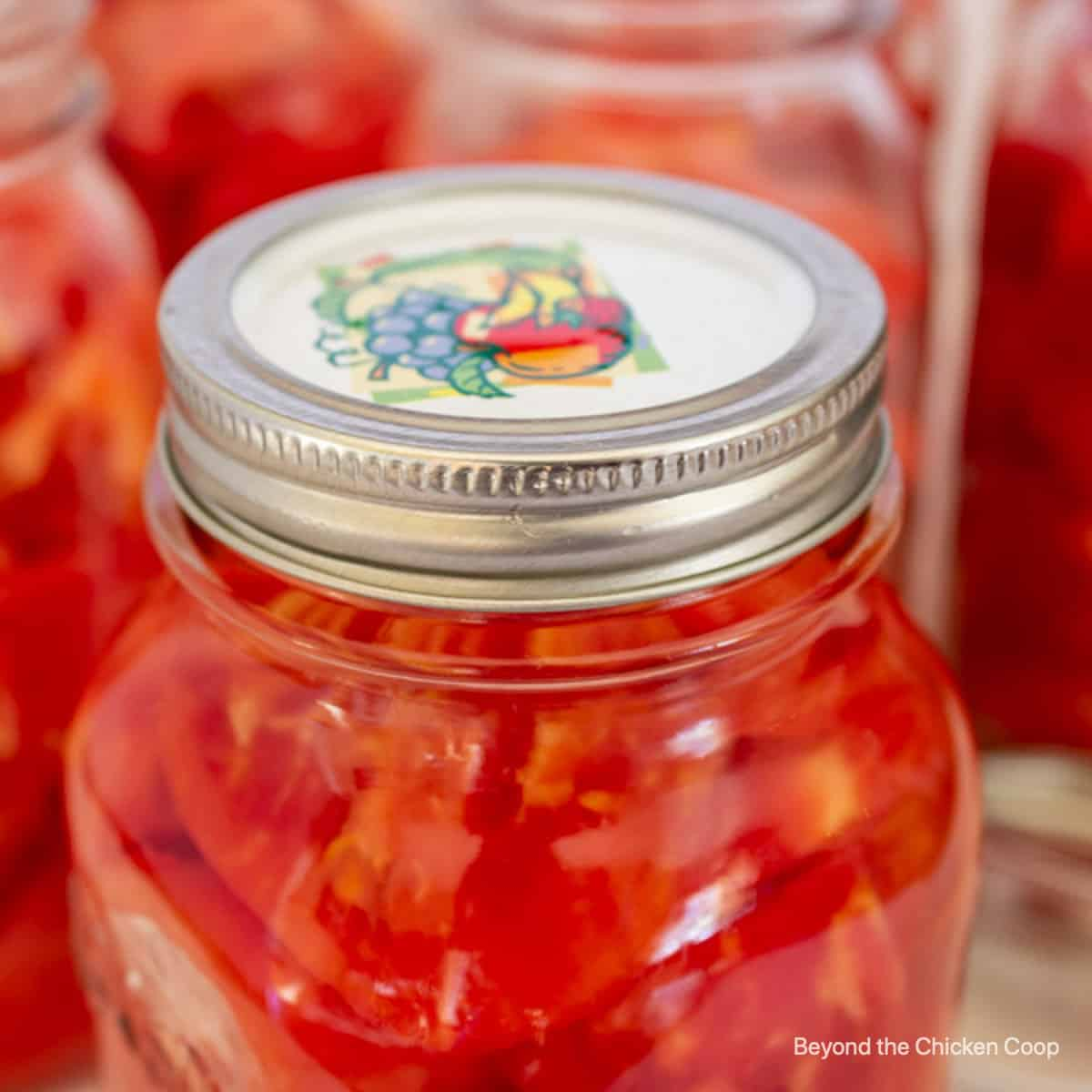 A jar of home canned tomatoes.