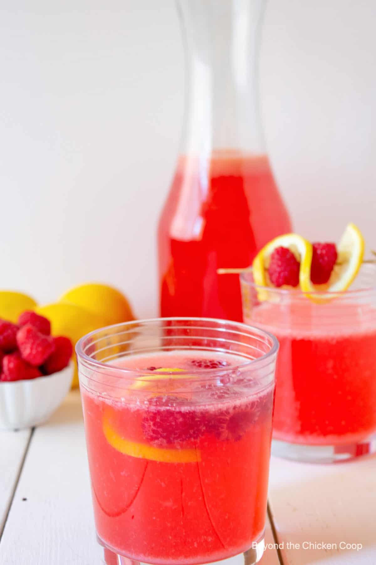 Two glasses of raspberry lemonade.