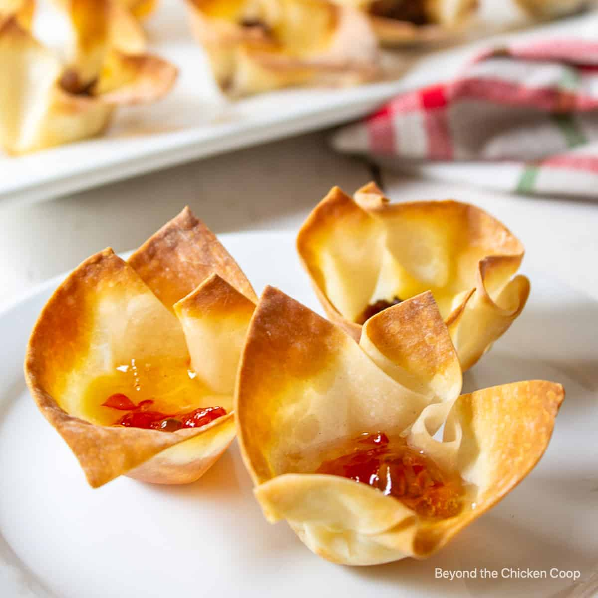 Wonton cups filled with cheese and pepper jelly.