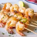 Skewered shrimp on a plate.