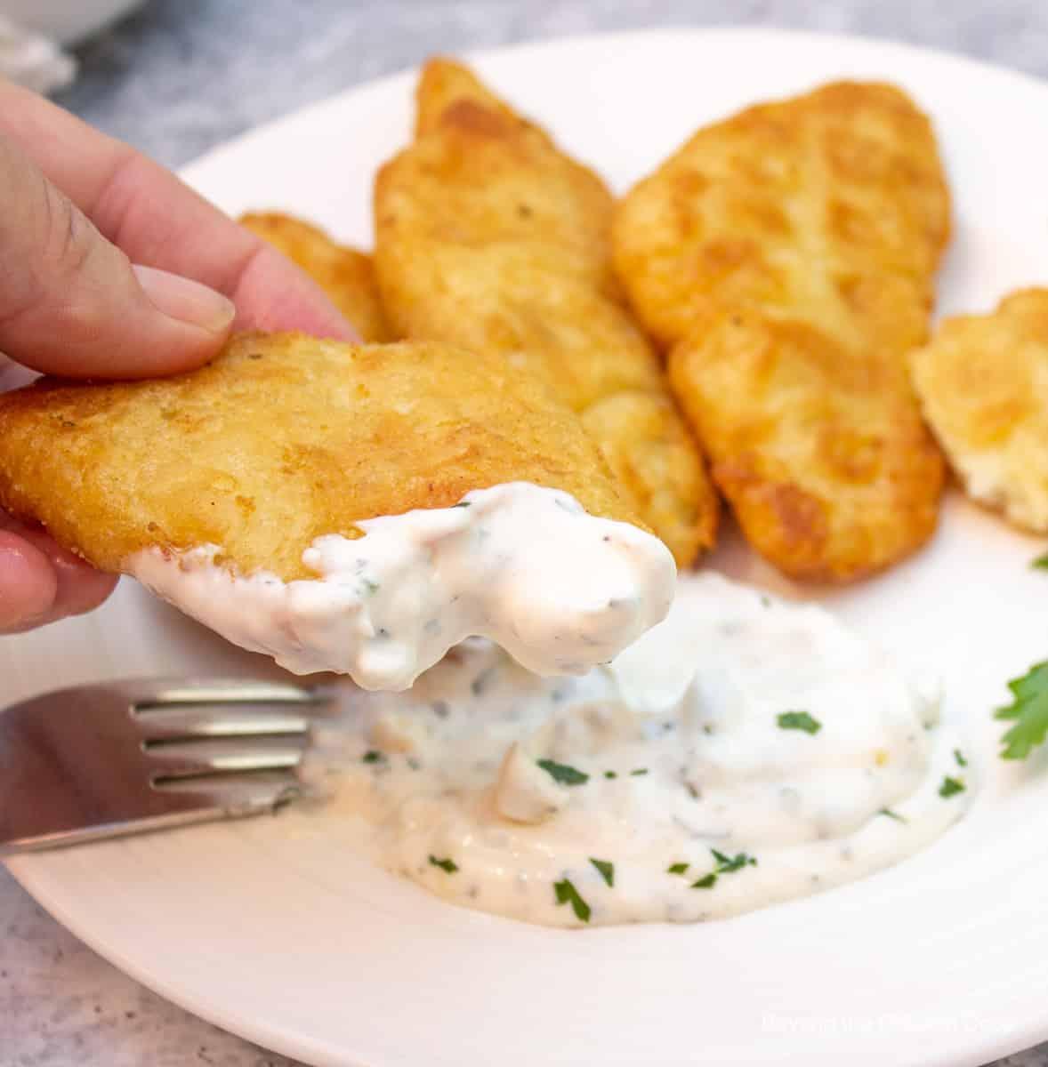 Tartar sauce on a piece of fish.