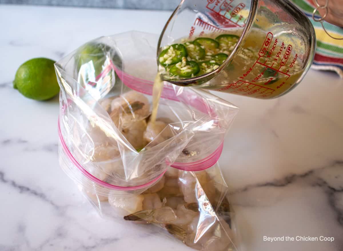 Pouring marinade into a bag with shrimp.