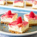 Stacked cheesecake bars with a raspberry swirl.
