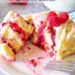 Sweet roll filled with raspberries and topped with fresh raspberries.