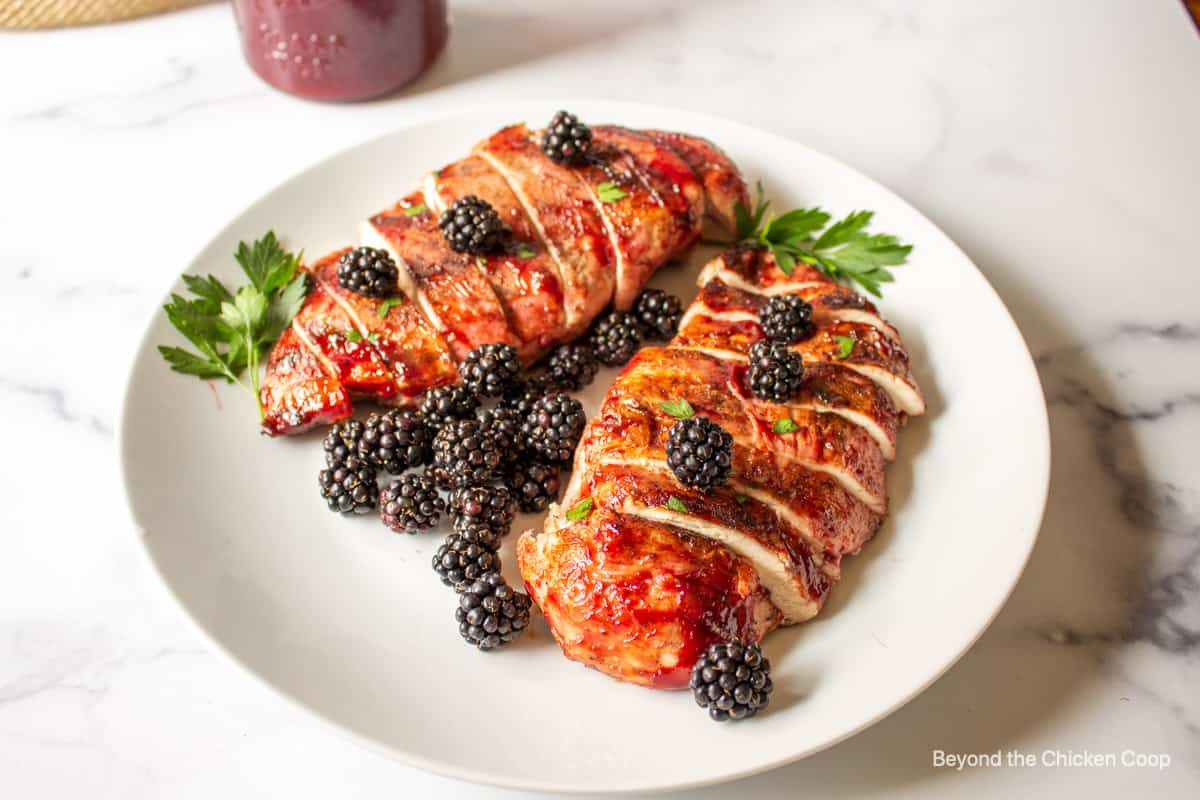 Grilled chicken breast topped with fresh blackberries and a BBQ sauce.