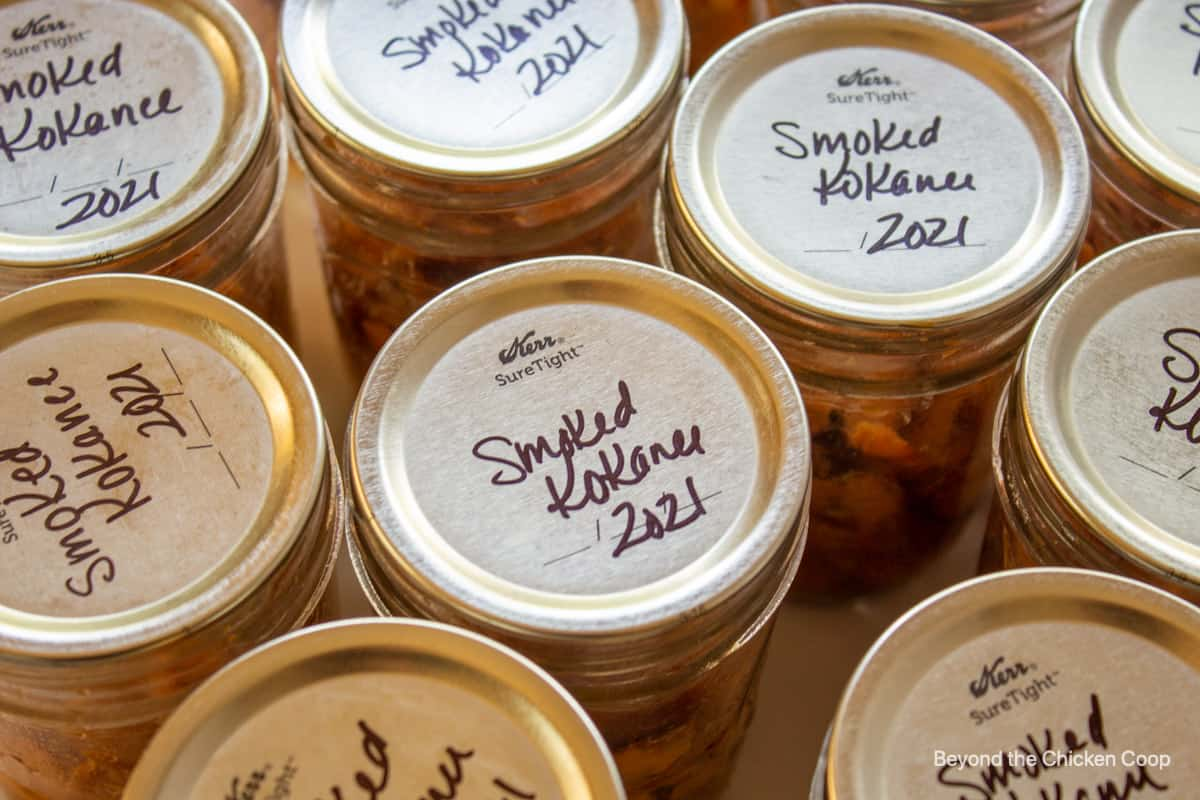 Jars of smoked kokanee with name and date.