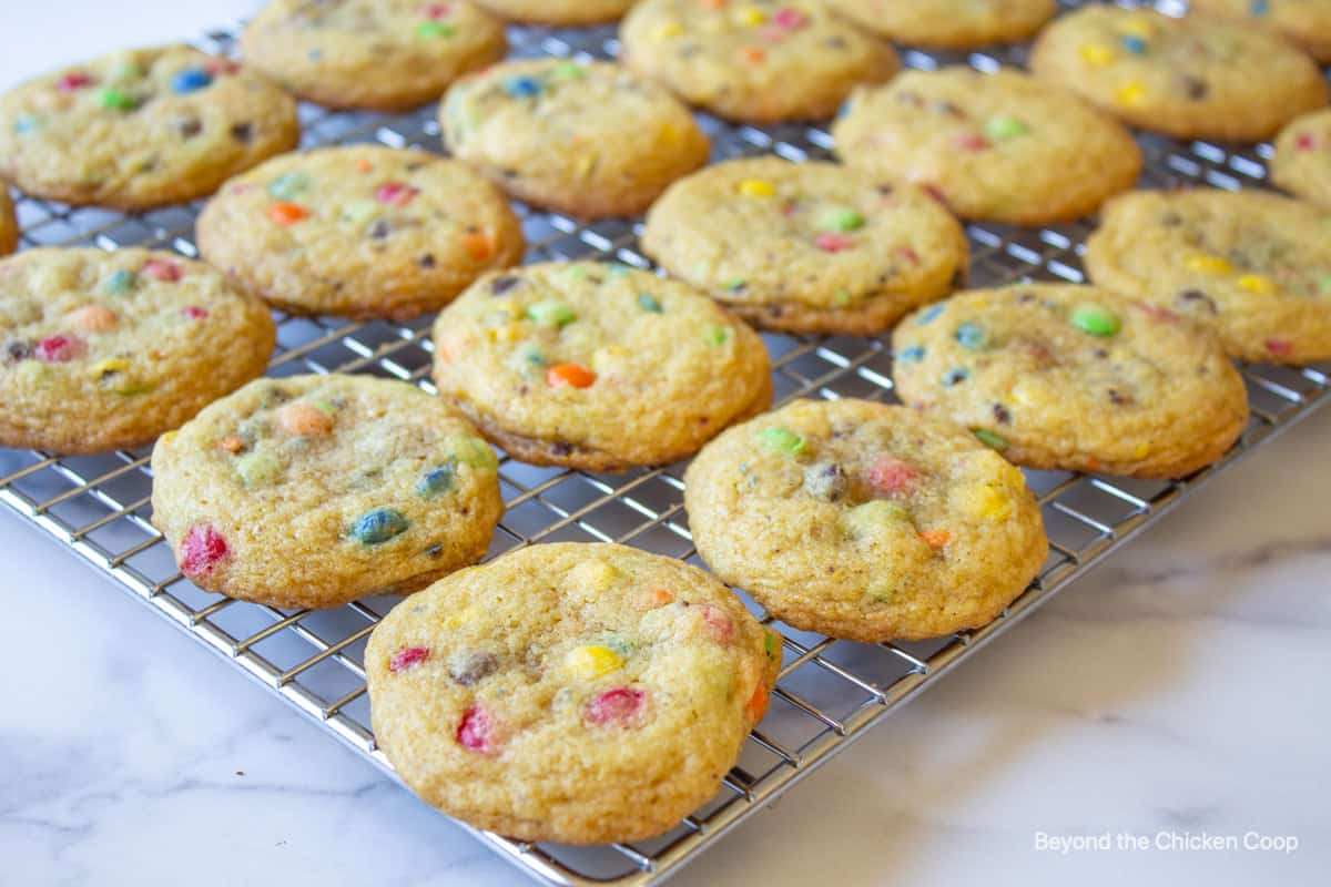 M and M cookies on a baking rack.