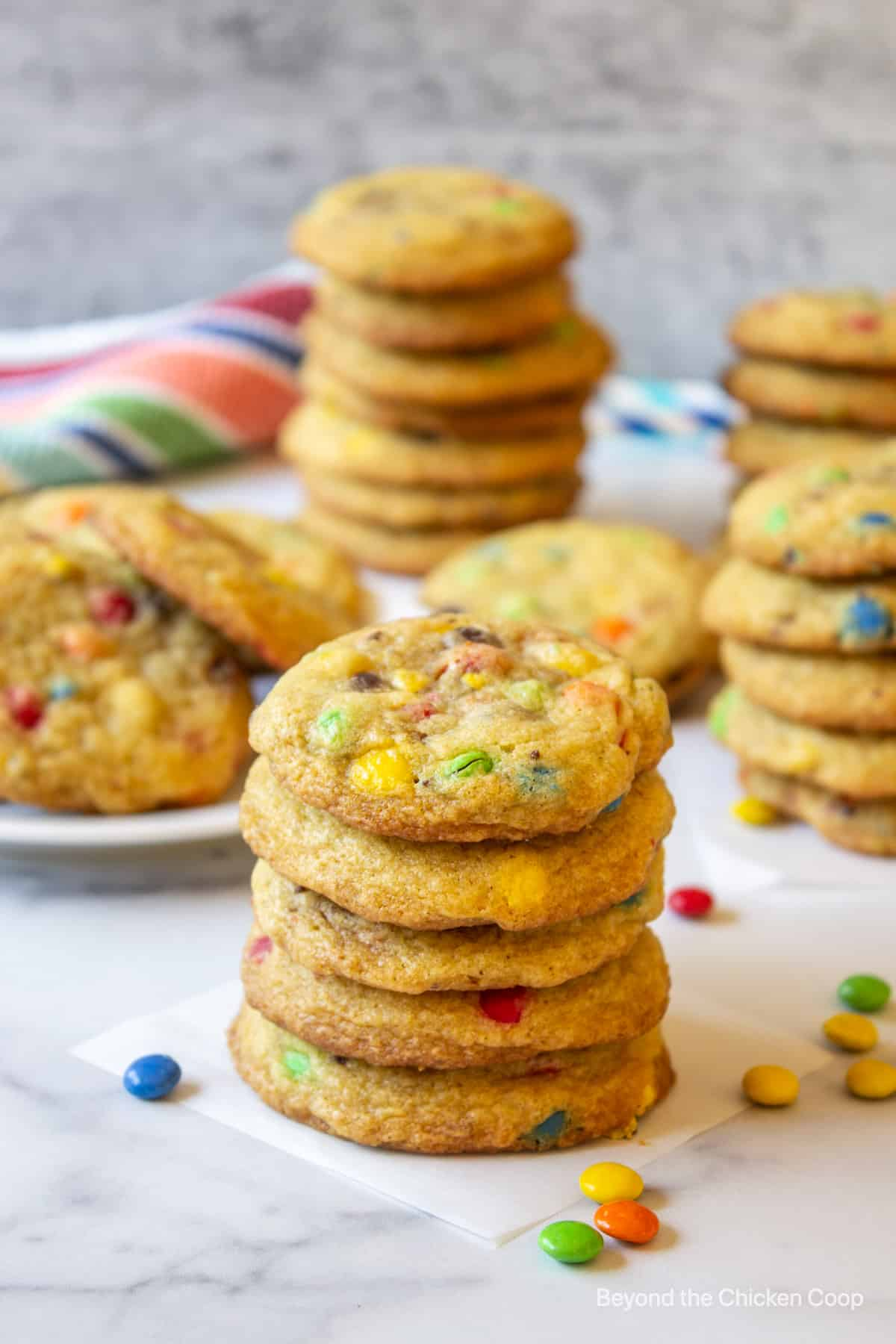 A stack of cookies filled with candy pieces.