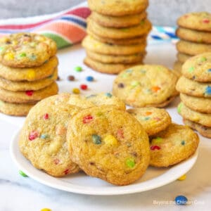 A plateful of cookies with candy pieces.