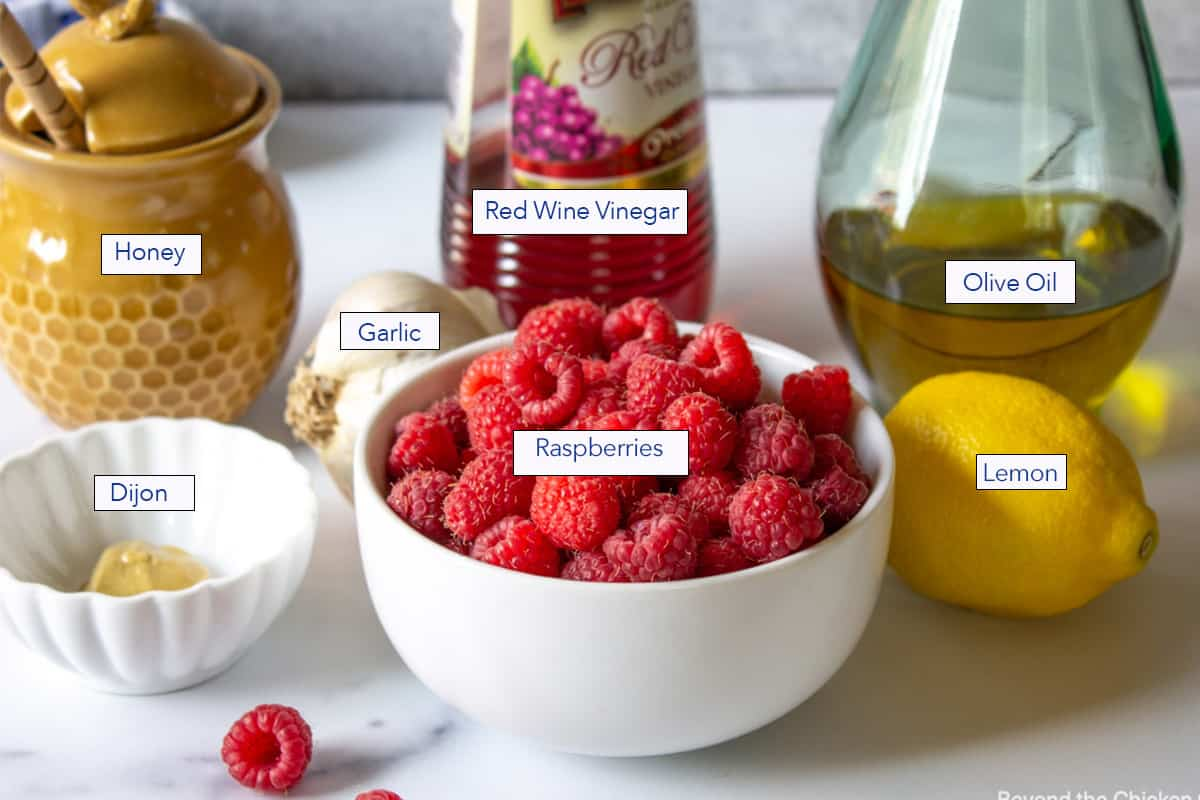 Ingredients for making a raspberry dressing.