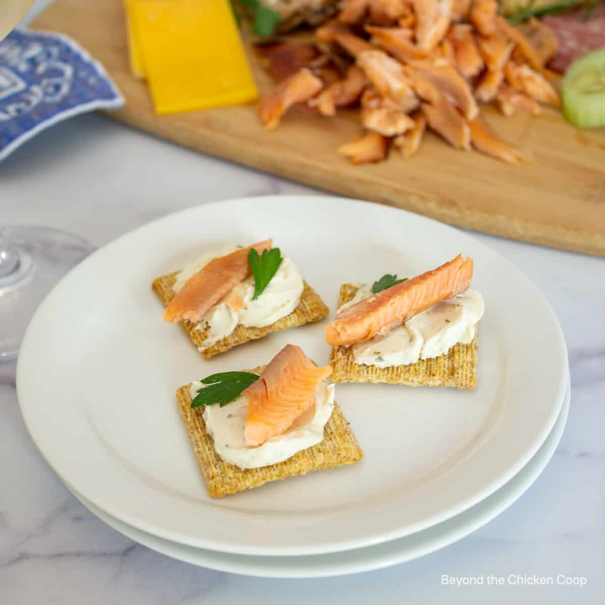 Smoked salmon on crackers with cream cheese.