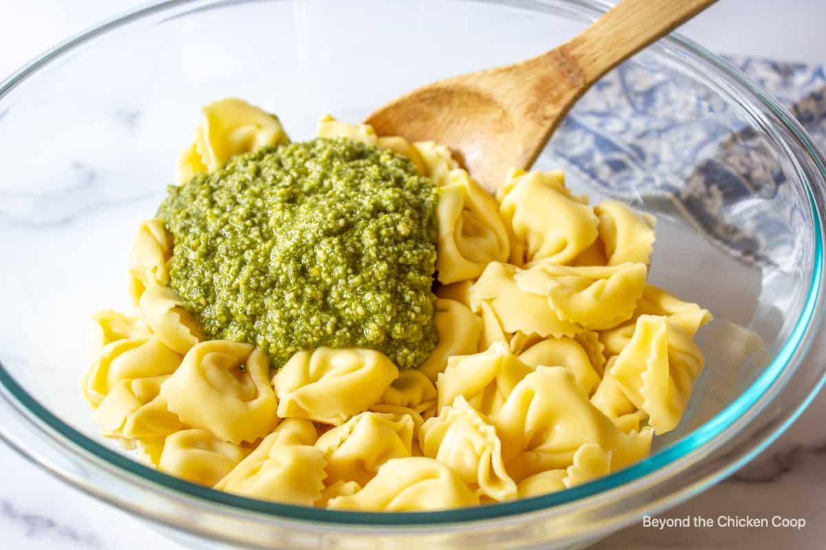 Pesto added to cheese tortellini.