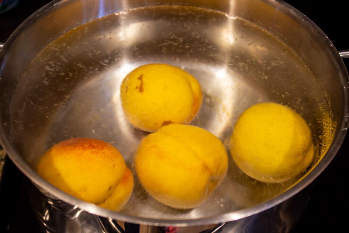 Peaches in a a hot water bath.