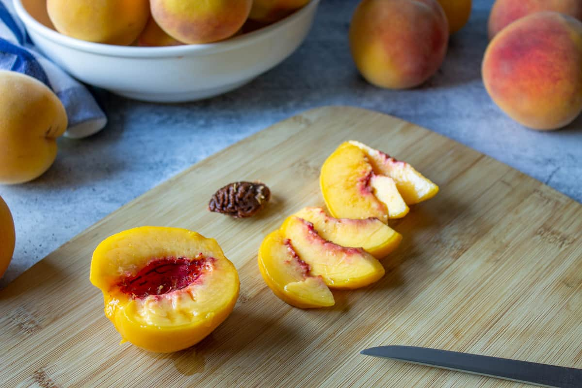 A peach cut in half with the pit removed.