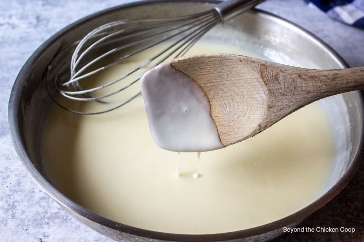 A thickened white sauce in a pan.