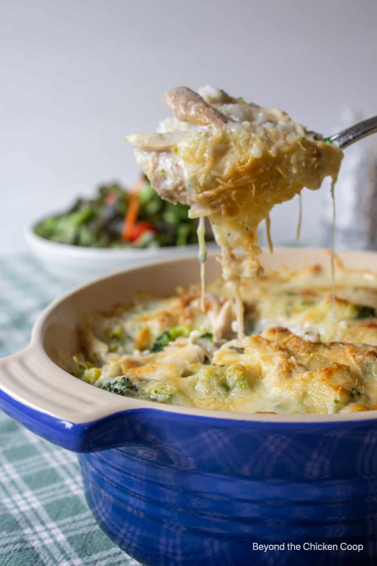 A spoonful of a cheesy casserole.