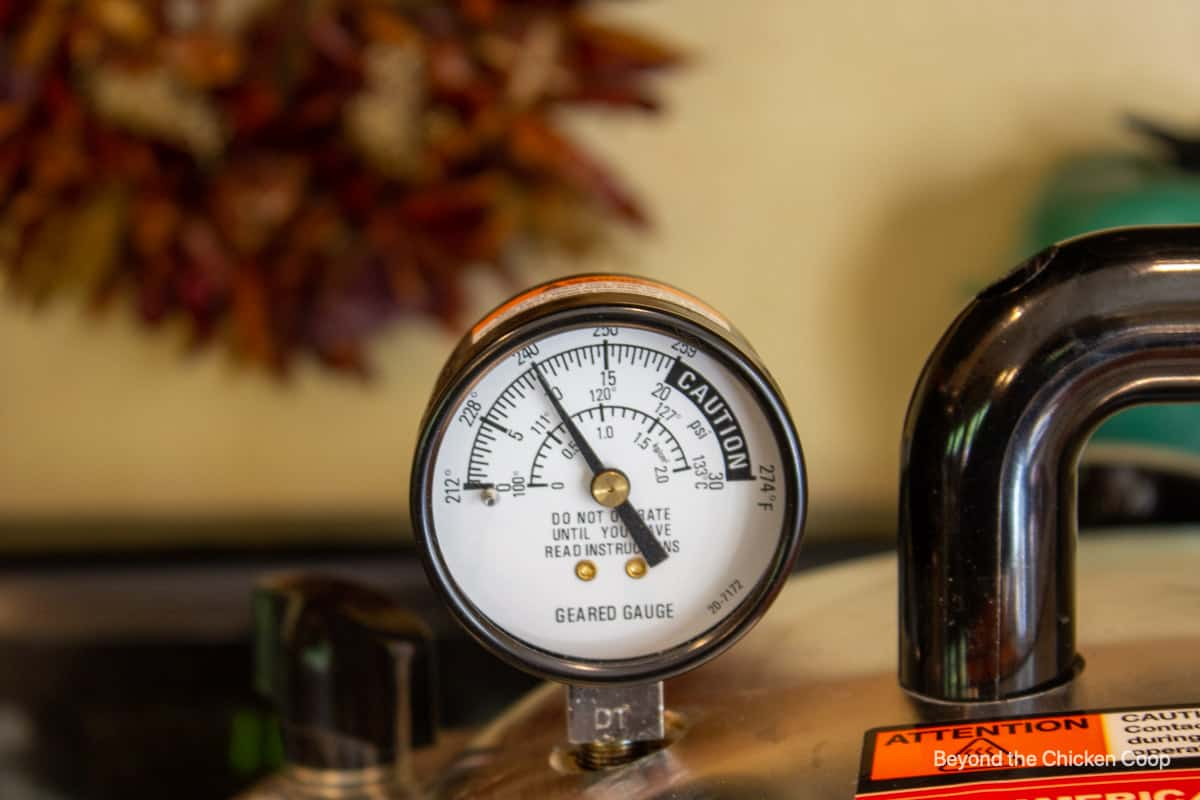 A pressure gage on top of a pressure canner.
