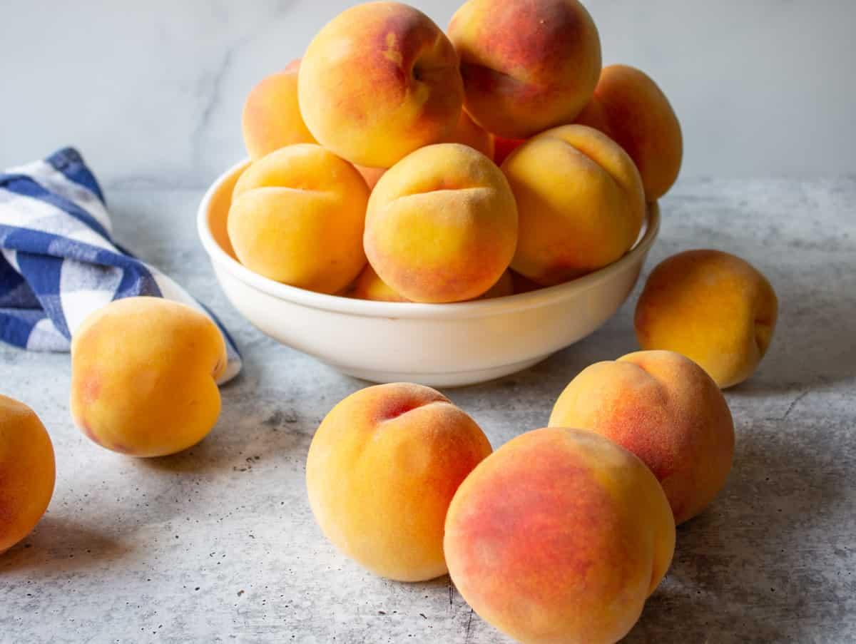 Fresh peaches on a counter.