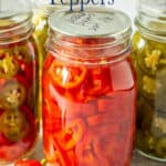 Canning jars filled with red and green chile peppers.
