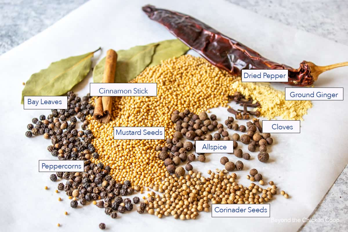 Spices and seeds on a board.