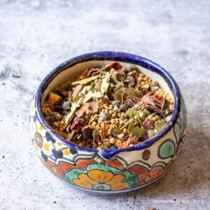 A colorful dish filled with pickling spice.