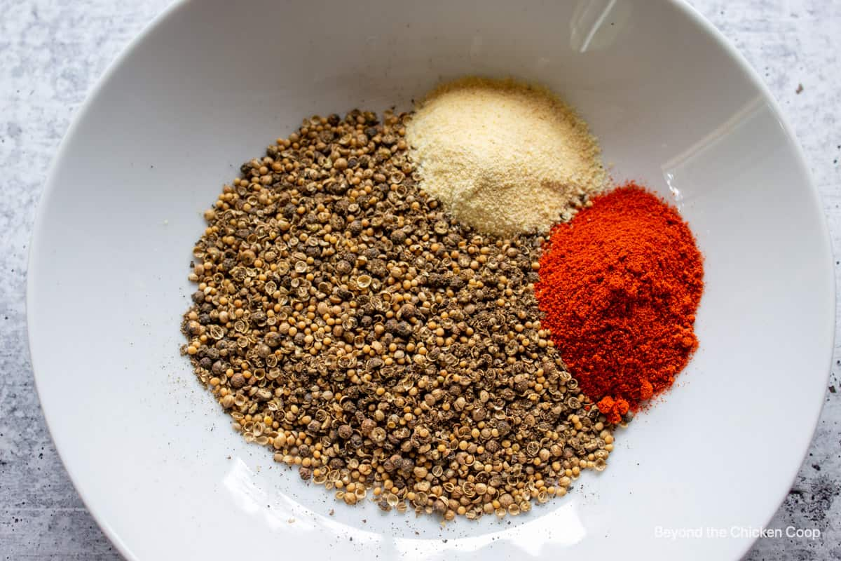 Ground spices with garlic powder and paprika.
