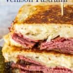 A reuben sandwich with pastrami, cheese and sauerkraut.