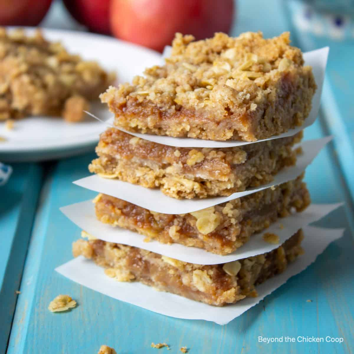 A stack of four oatmeal bars with an applesauce filling.