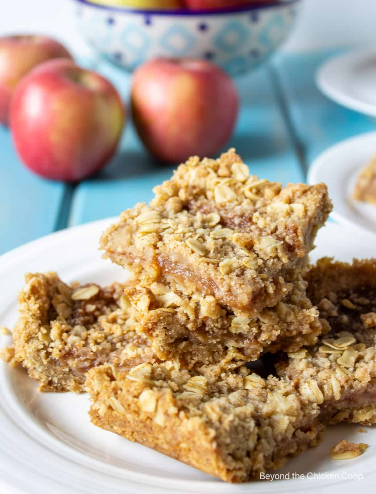 Oat bars stacked on a white plate.