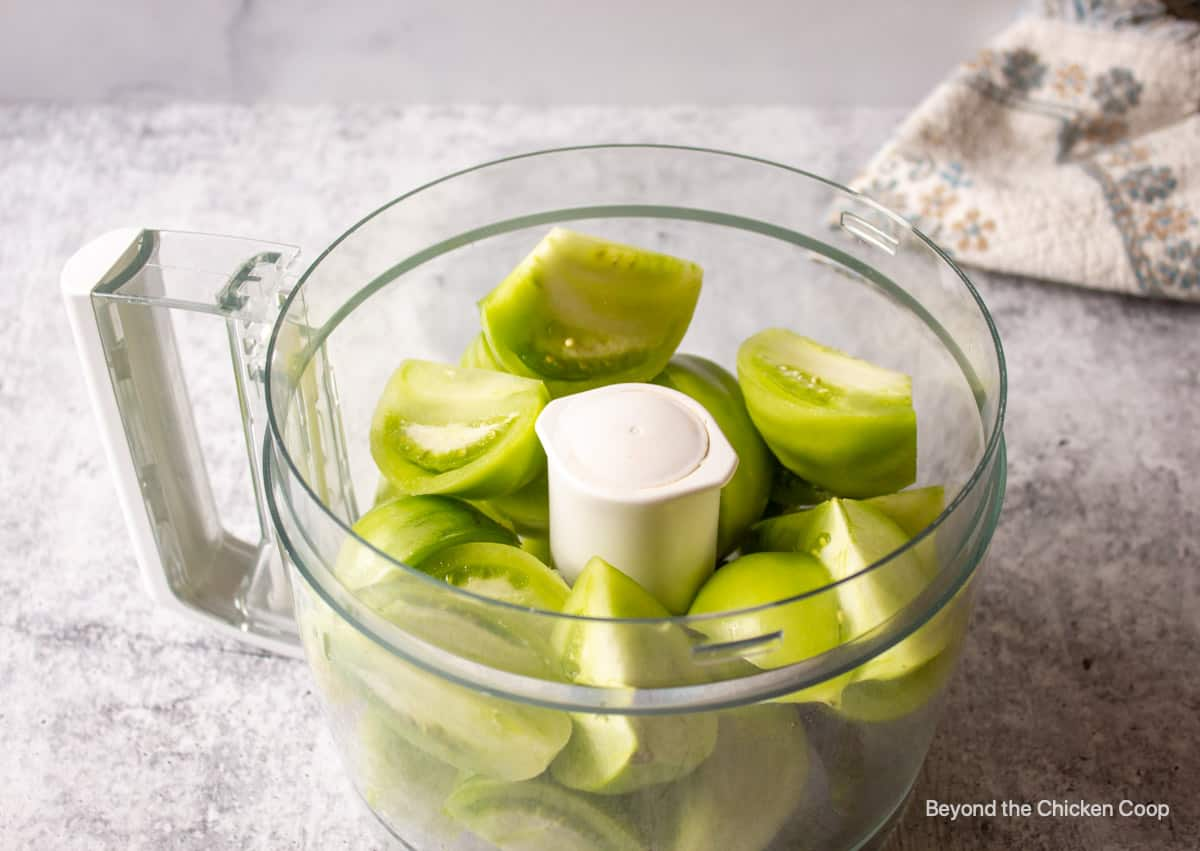 A bowl with quartered green tomatoes.