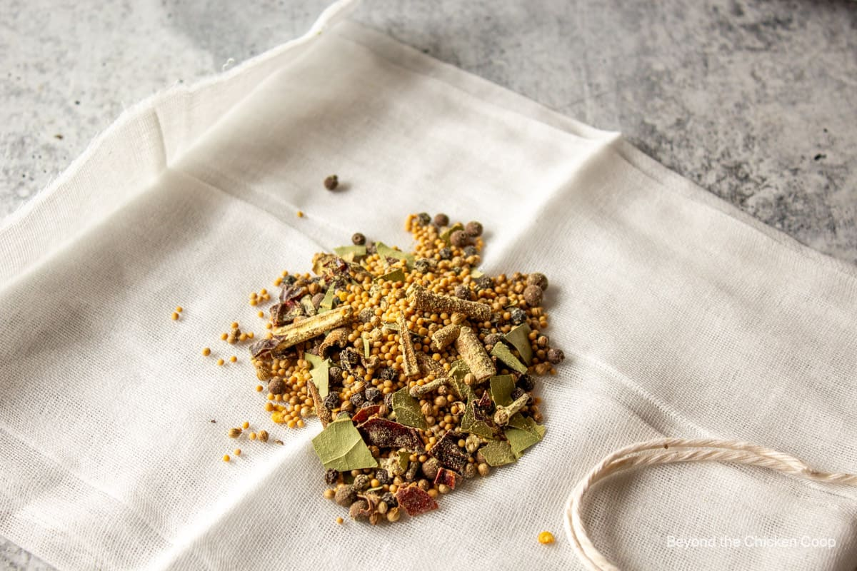 Pickling spices on cheesecloth.